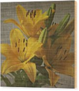 Yellow Lilies With Old Canvas Texture Background Wood Print