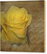 Yellow Rose With Old Notes Paper On The Background Wood Print