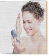Young Beautiful Woman Applying Powder On Her Skin. Wood Print