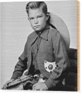 Young Cowboy Sitting Wood Print