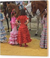Young Girls In Flamenco Dresses Looking At Horses At The April F Wood Print