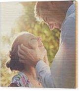 Young Romantic Couple Flirting In Sunshine Wood Print