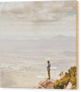 Young Traveler Looking At Mountain Landscape Wood Print