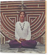 Young Woman Sitting And Meditating In A Lotus Position In Front Of A Unique Doors Wood Print