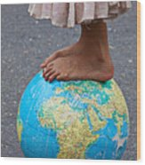 Young Woman Standing On Globe Wood Print