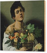 Youth With A Basket Of Fruit Wood Print by Michelangelo Merisi da Caravaggio