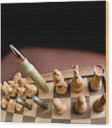 Chess Board And Bullets. Wood Print