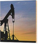Dawn Over Petroleum Pumps In The Desert Wood Print