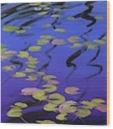 Lilies On Blue Water Wood Print
