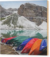 Moraine Lake Canoes Wood Print