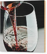 Red Wine Being Poured In A Glass Wood Print