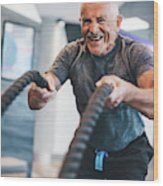 Senior Man Exercising With Ropes At The Gym. Wood Print