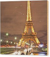 The Eiffel Tower Lit Up At Night In Wood Print