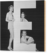 Women Posing With Huge Letter E Wood Print