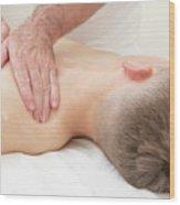 Teenage Boy Laying On A Massage Table Wood Print