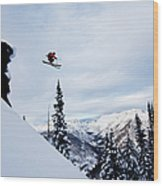 A Athletic Skier Jumping Off A Cliff In Wood Print