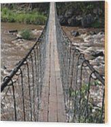 A Long Suspension Bridge Over A River Wood Print