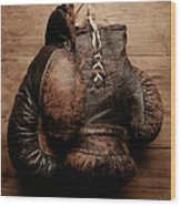 A Pair Of Worn Old Boxing Gloves On Wood Print