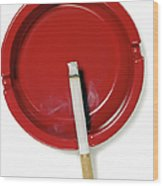 A Red Ashtray With A Burning Cigarette Wood Print