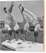 Acrobats Eat While Doing Handstands Wood Print