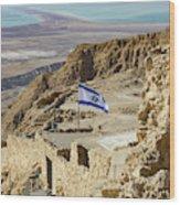 An Israeli Flag Flies Near The Entrance To The Top Of Masada In  Wood Print