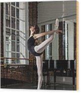 Ballerina Performing Attitude In Dance Wood Print