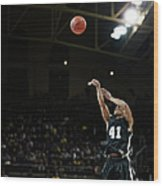 Basketball Player Shooting Jump Shot In Wood Print