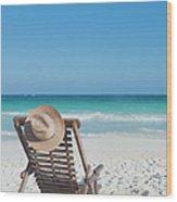 Beach Chair With A Hat On An Empty Beach Wood Print