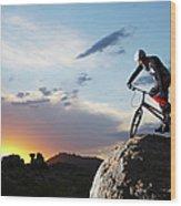 Bike Rider Balancing On Rock Boulder Wood Print