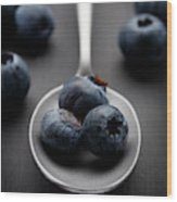blueberries and a silver spoon on distressed wood No. 2 Wood Print
