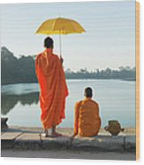 Buddhist Monks Standing In Front Of Wood Print