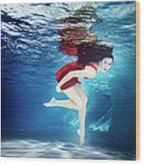 Caucasian Woman In Dress Swimming Under Wood Print