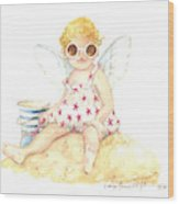 Cherub In The Sand Wood Print
