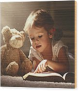 Child Little Girl Reading A Magic Book Wood Print