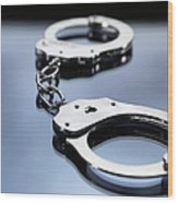 Close Up Of Metal Handcuffs Wood Print
