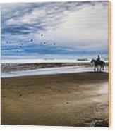 Cowboy Riding Horse On Beach Wood Print