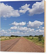 Dirt Road And Puffy Clouds Wood Print