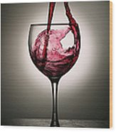 Dramatic Red Wine Splash Into Wine Glass Wood Print