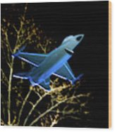 F 16 Lit Up At Night On Glass Monument Wood Print