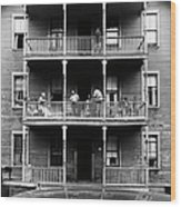 Family On Balcony Of Apartment Building Wood Print