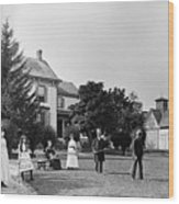 Family Plays Croquet In Front Of Home Wood Print