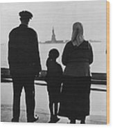 Family Views Statue Of Liberty From Wood Print
