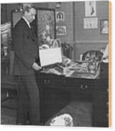 Florenz Ziegfeld Looking At Photographs Wood Print