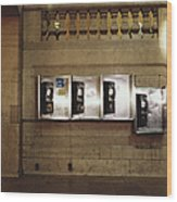 Four Telephone Booths On Marble Wall Wood Print