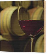 Glass Of Red Wine In Wine Cellar Wood Print