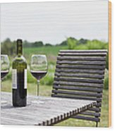Glasses And A Bottle Of Red Wine On An Wood Print