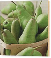 Green Pears In Punnet And Wooden Table Wood Print