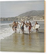 Group Of Surfers Running In Water With Wood Print