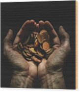 Hands Holding Coins Against Black Wood Print