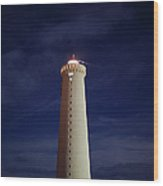 Lighthouse Against Sky With Stars Wood Print